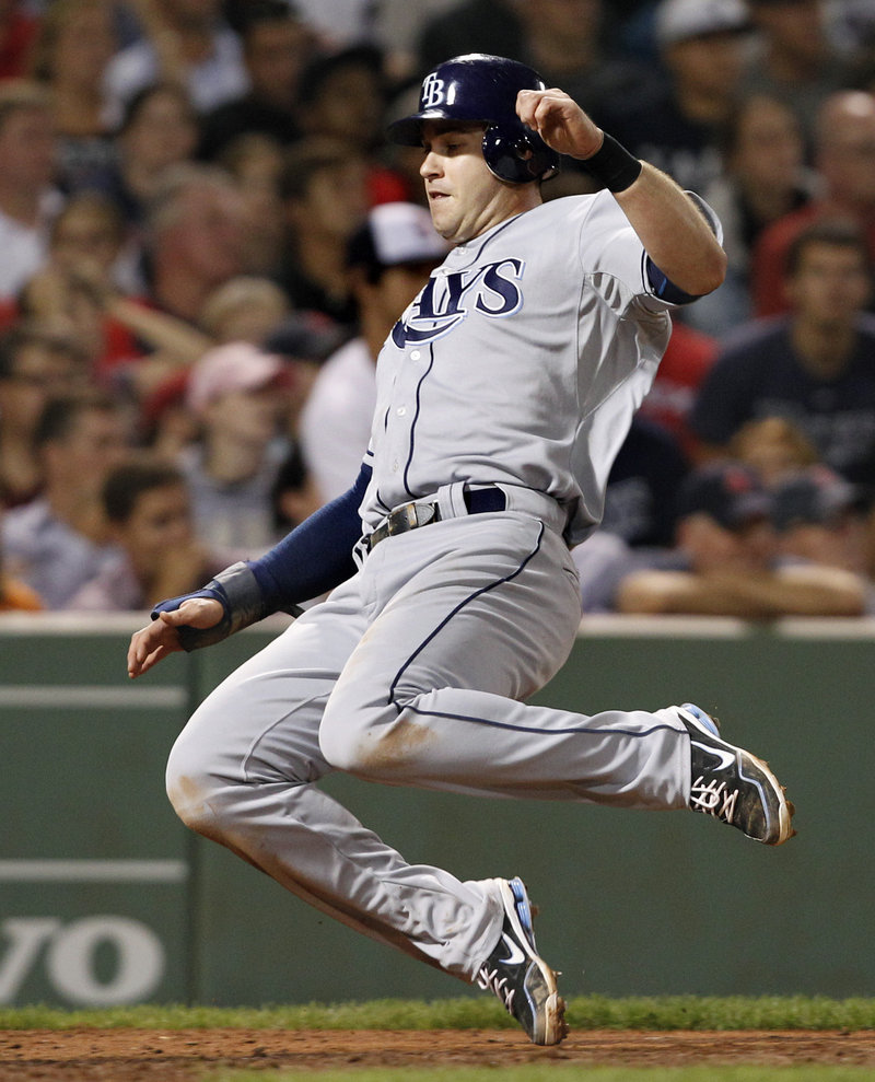 Evan Longoria of the Tampa Bay Rays slides into home to score on B.J. Upton's single Tuesday night in the eighth inning of the second game against the Boston Red Sox.