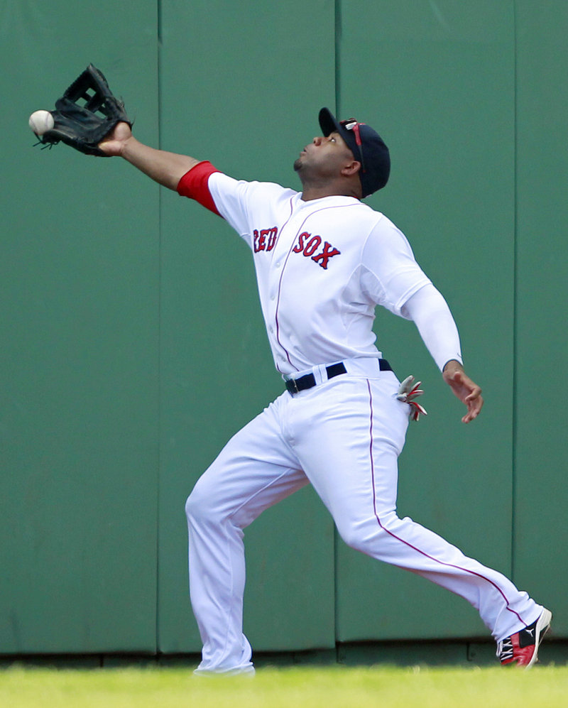 Carl Crawford of the Boston Red Sox just misses a foul ball down the left-field line hit by Desmond Jennings of the Tampa Bay Rays during the Rays' 4-0 victory at Fenway Park.