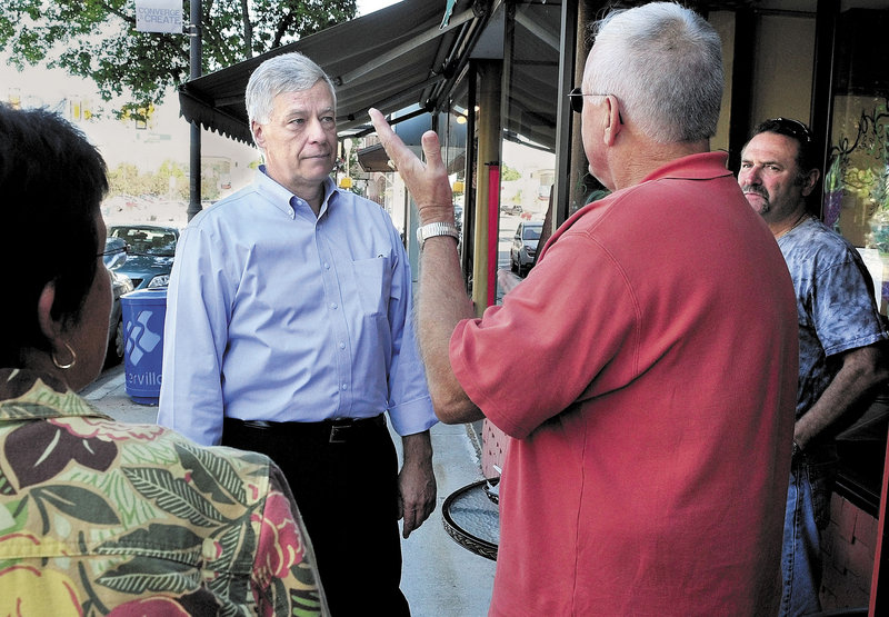 U.S. Rep. Mike Michaud, D-2nd District, center, speaks with Kelly Wynn, left, and Marc Bizier during a walking tour in downtown Waterville on Wednesday. Michaud spoke with many people regarding the need to redraw boundaries for the state's two congressional districts.