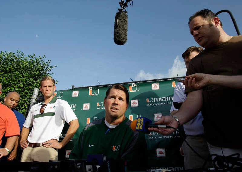 Al Golden, center, the Miami football coach, can only wait and see what will happen to his program in the wake of allegations of improper benefits over an eight-year period.