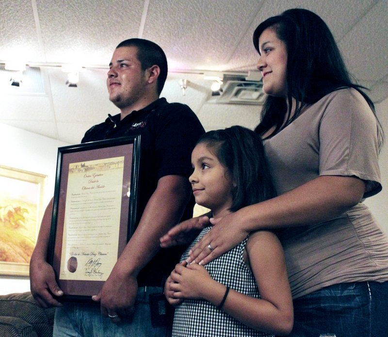Antonio Diaz Chacon poses with his wife, Martha, and their daughter Brisseida after he was recognized for his heroism during a ceremony in Albuquerque, N.M., on Friday.