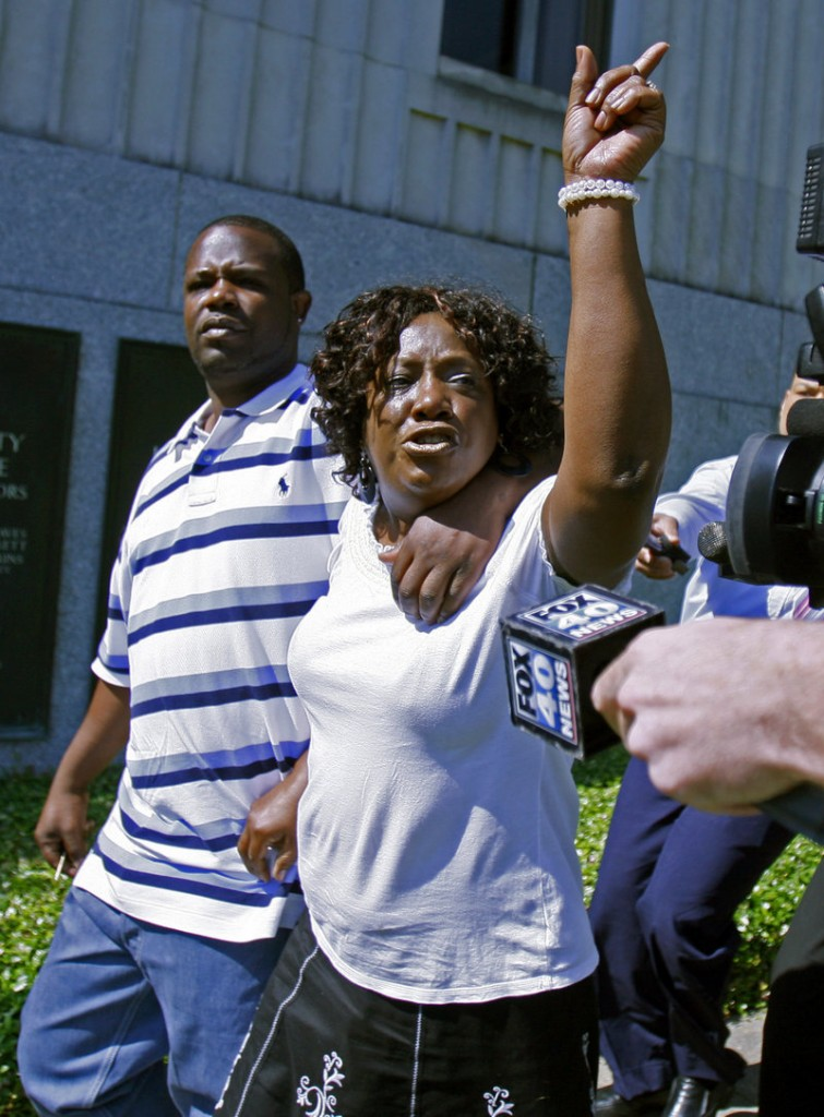 """Ablene Cooper and her son Antonio Cooper leave a courthouse in Jackson, Miss., after her lawsuit against """"The Help"""" author Kathryn Stockett was dismissed last week."""