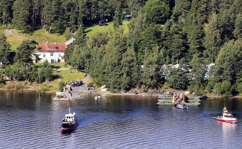 "Boats drop off massacre survivors and their relatives Saturday on Norway's Utoya island. Up to 1,000 visitors were expected, many lighting candles and laying personal notes where victims were shot. ""There was an extreme mix of feelings,"" said survivor Stine Renate Haaheim."