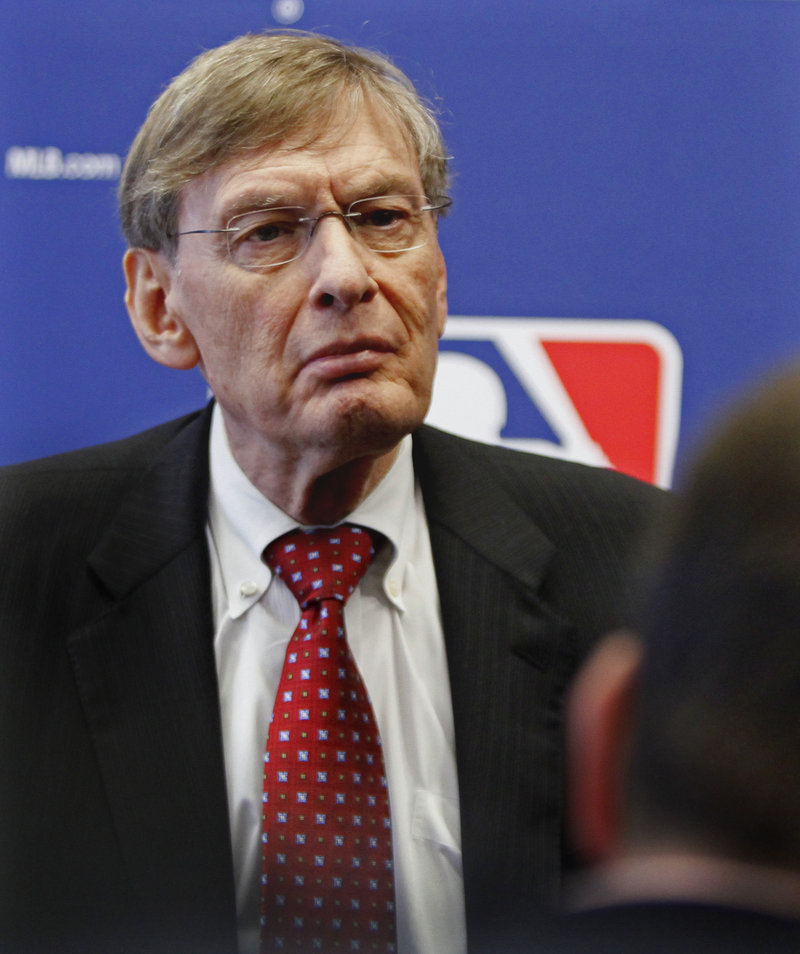 Bud Selig, the baseball commissioner, is said to favor adding two playoff teams next season in a structure that would give a geater benefit to teams winning their division.