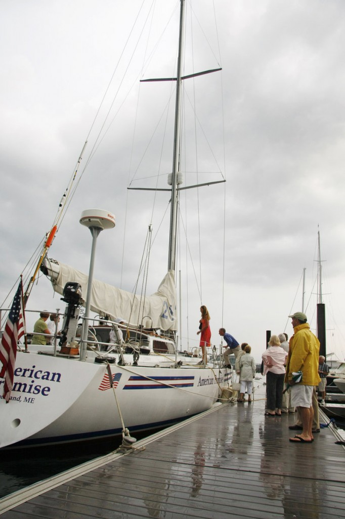 Visitors board American Promise in Portland after a tribute to Dodge Morgan on the 25th anniversary of his solo sail around the world.