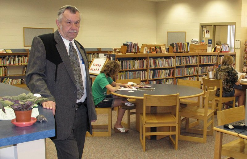 Irene-Wakonda School District Superintendent Larry Johnke stands in the high school library. The district has adopted a four-day week as state funding for schools is reduced.