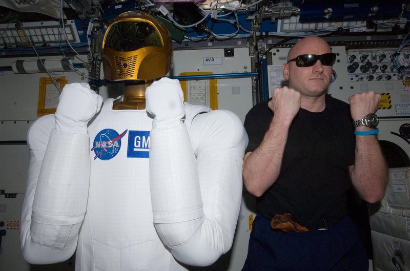 Astronaut Scott Kelly poses with Robonaut 2, the dexterous humanoid astronaut helper, in the Destiny laboratory of the International Space Station earlier this year.