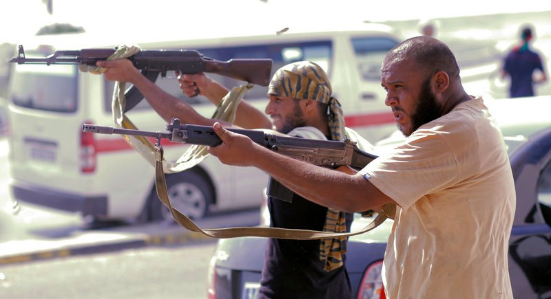 Libyan rebel fighters shoot toward pro-Gadhafi forces during fighting Monday in downtown Tripoli.