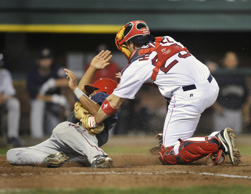 Portland catcher Jeff Howell tags out Josh Johnson of the Senators on a throw from first baseman Jon Hee in the sixth inning Monday night.