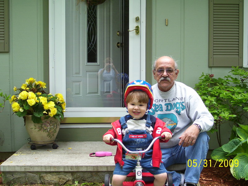 "Robert La Guardia sits for a photo with his grandson, Thomas, in May of 2009. Mr. La Guardia, who died Sunday, ""was a really generous person"" who loved kids and loved playing with Thomas, who called him ""Duckie,"" his daughter said."