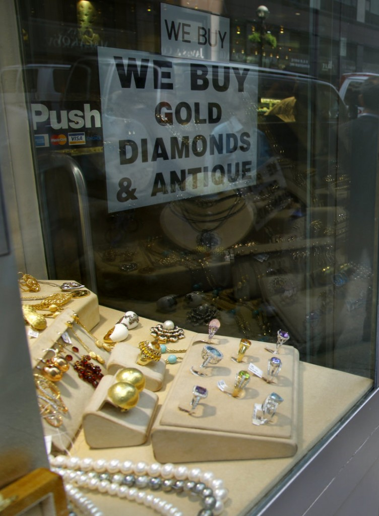 A jewelry store advertises in New York. The danger of investing in gold is that it has no intrinsic value.