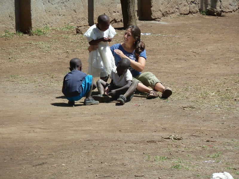"Becky Schaffer plays with children in Gilgil, Kenya, in June 2010. ""(She) loved making the kids smile,"" her sister said."