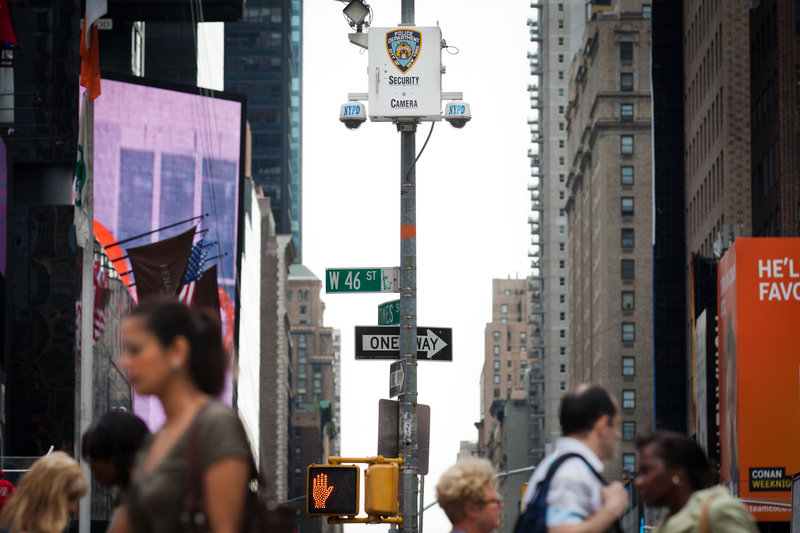 New York City pedestrians in Times Square start their morning Tuesday under the watchful eyes of surveillance cameras. The New York Police Department has become one of the country's most aggressive domestic intelligence agencies.