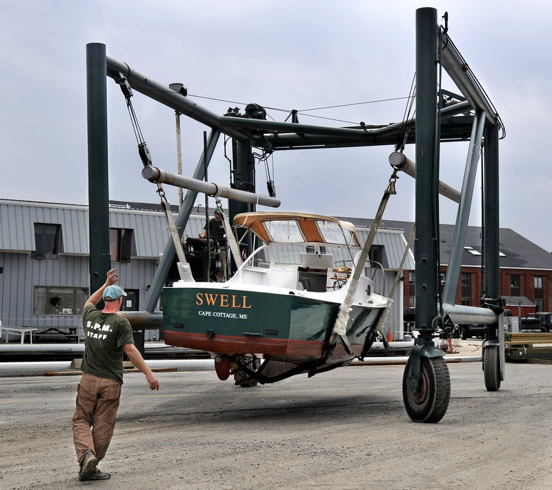 Crews at South Port Marine in South Portland stayed busy Thursday hauling boats from Portland Harbor in advance of the battering winds and surf expected from Hurricane Irene.