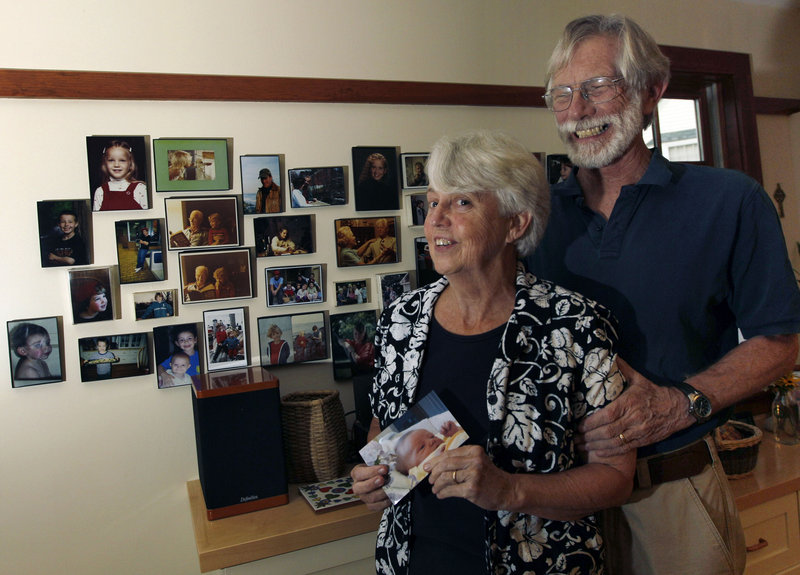 Eileen and Doug Flockhart show off a wall of family photos at their home in Exeter, N.H. Grandparents are growing in numbers at twice the rate of the overall U.S. population.
