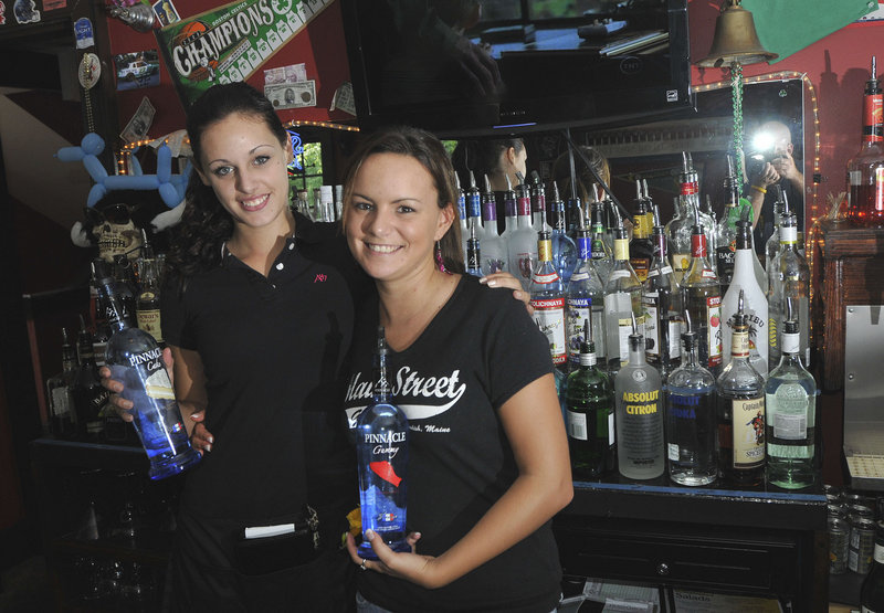 Shift leader Robin Gallant, left, and bartender Elizabeth Smith with raw materials at Maine Street Grill in Standish