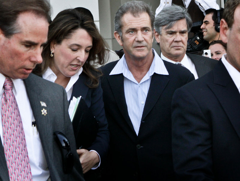 Actor Mel Gibson, right, leaves Los Angeles Airport Courthouse after facing charges of domestic violence March 11. He and ex-girlfriend Oksana Grigorieva have been in a custody and financial battle for more than a year.