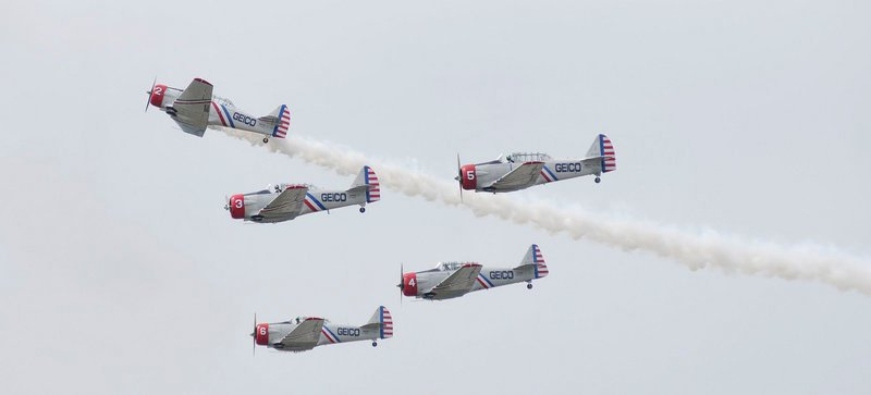 The GEICO Skytypers Air Show Team maintains a tight formation in World War II era planes during the Great State of Maine Air Show in Brunswick on Saturday. Today's show was canceled because of the weather.