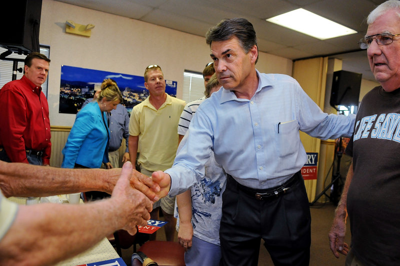 Republican presidential candidate Texas Gov. Rick Perry stops at Tommy's Country Ham House in Greenville, S.C. One state official said the safety of Perry and his family could be jeopardized if his travel security arrangements are made public.