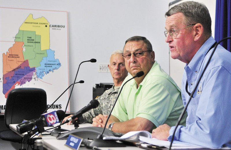 "Maj. Gen. John W. ""Bill"" Libby, commissioner of the Department of Defense, Veterans and Emergency Management, left, and Gov. Paul LePage listen as Maine Emergency Management Agency Director Robert McAleer talks about Hurricane Irene during a news conference on Saturday at the MEMA headquarters in Augusta."