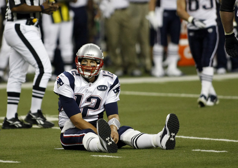 Patriots quarterback Tom Brady spent much of Saturday's preseason game against the Lions picking himself up off the turf after being pressured constantly by Detroit's defensive line. Brady was sacked twice and completed just 12 of 22 passes for 145 yards, with one TD and one interception.