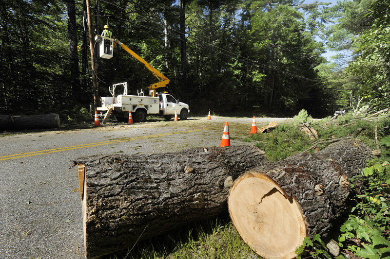 On Outlet Road in New Gloucester, a lineman for the Telephone Guys company works to restore service Monday.