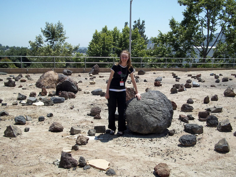 """Fourteen-year-old Zoe Bentley stands in the Mars Yard at NASA's Jet Propulsion Laboratory in Pasadena, Calif., last year. As an """"unschooler,"""" Zoe's favorite subject is exogeology, the study of geology on other planets."""