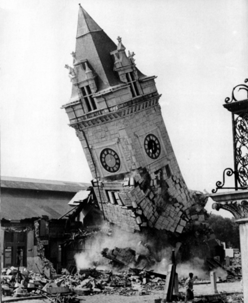 The distinctive, 138-foot-tall clock tower crumbles to the ground as Union Station is demolished in 1961 to make way for a strip mall.