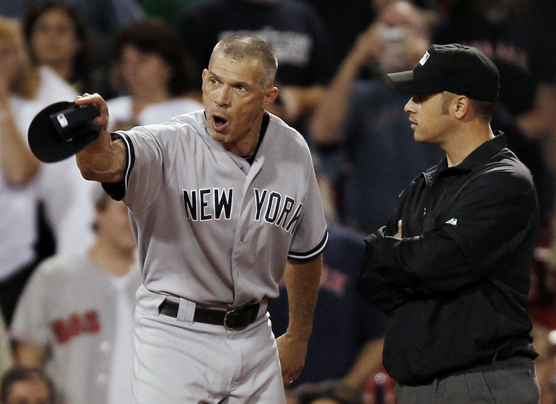 Yankees Manager Joe Girardi gets the final word in an argument with third-base umpire Mark Wegner in the ninth inning Tuesday night. They were Girardi's final words of the game, period. He was ejected by Wegner.