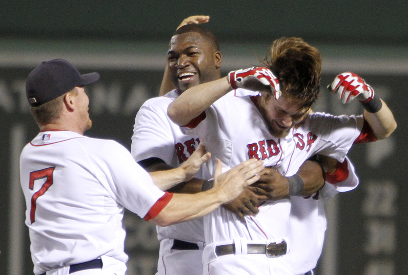 Boston's J.D. Drew, David Ortiz and Josh Reddick celebrate Reddick's RBI single that gave the Red Sox a walk-off 3-2 win against the New York Yankees in the 10th inning Sunday.