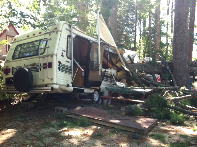 A trailer at Nason's Beach and Campground off Route 114 in Sebago was partially crushed by a tree Sunday.