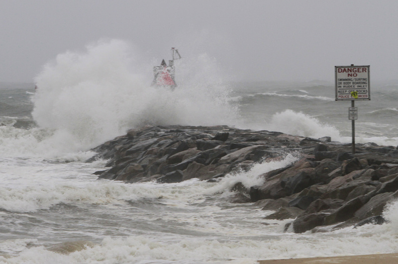 Waves and wind from Hurricane Irene pound the Rudee inlet jetty in Virginia Beach , Va., today.