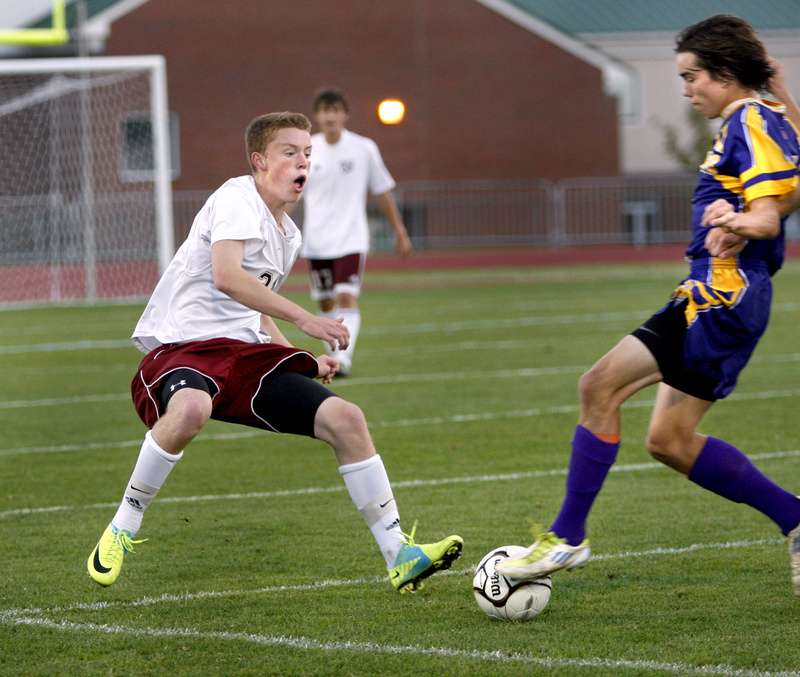 Elliot Maker of Cheverus High School, right, gains control of the ball as Christian Hewitt of Windham High School attempts to slow Maker down during Cheverus' 2-0 victory in a boys' soccer game Tuesday.