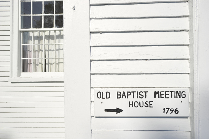 Vintage sign on the exterior of the Old Baptist Meeting House.