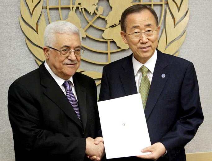 Palestinian President Mahmoud Abbas, left, poses with Secretary-General Ban Ki-moon after giving him a letter requesting recognition of Palestine as a state at United Nations headquarters today.