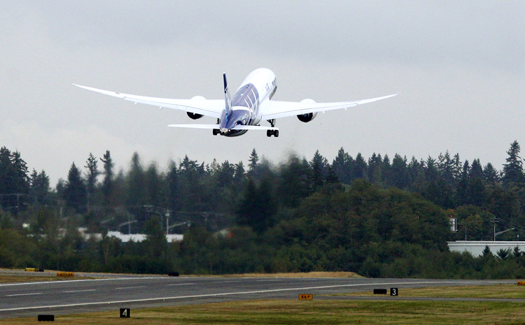 The first Boeing Co. 787 plane delivered to a commercial customer takes off for Japan today in Everett, Wash. The plane will be operated by Japan's All Nippon Airways.