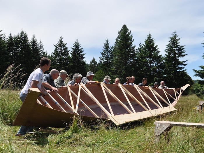 In this June 2011 photo, the 36-foot replica of a canoe stolen from the Chinook Indians is under construction in Veneta, Ore.