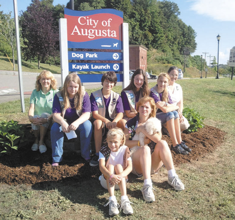 DOG PARK A GROUP EFFORT: Marianne Sansouci and Michelle Brown were dismissed as leaders of an Augusta-based Girl Scout troop after soliciting funds for a community service project. Involved in the project were, back row from left, Jeanne Gibson, Desiree Lyon-Johnson, Yulia Gibson, Jessica Gargiulo, Sydney Sansouci and Marianne Sansouci; and front row, Jillian Brown, left, and Michelle Brown.