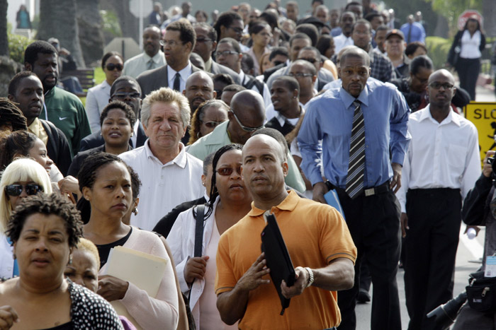 An estimated 4,000 people wait to enter a job fair called the