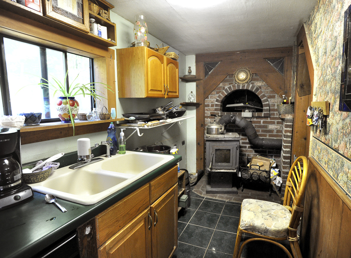 A small wood stove in Michael Mayhew's kitchen supplements solar heat during the colder days.