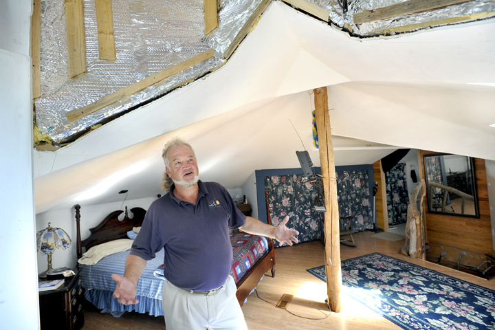 Michael Mayhew is still working on the insulation in the ceiling of his new master bedroom.