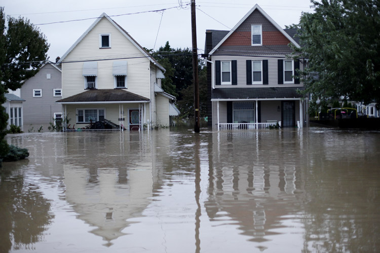 Floodwaters from the Susquehanna River partially submerge homes today in West Pittston, Pa.
