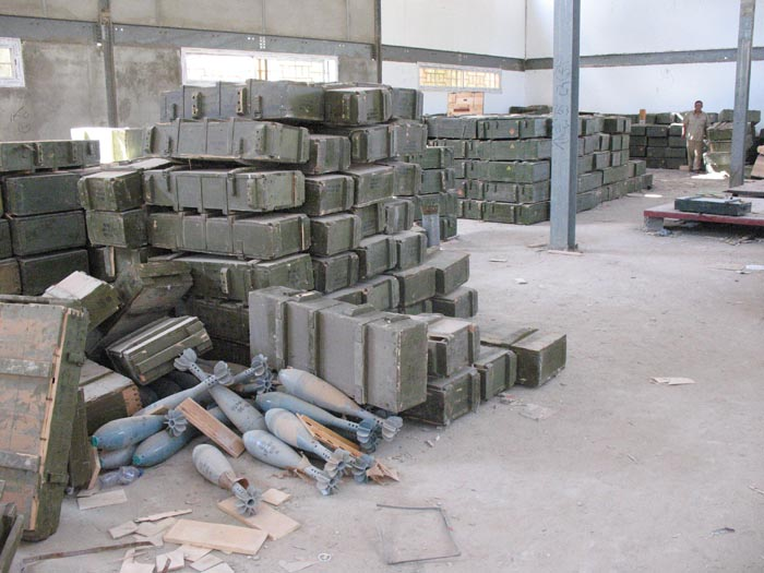 Large mortar shells sit unguarded, and boxes that once held anti-aircraft missiles and other heavy weapons are strewn about arms depots around Tripoli last week. Former rebels say they've taken some ammunition for the fight against supporters of Moammar Gadhafi, but U.S. officials and others express fears the weapons could fall into the wrong hands.