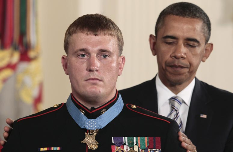 President Barack Obama awards the Medal of Honor to former Marine Corps Cpl. Dakota Meyers, 23, from Greensburg, Ky., today during a ceremony in the East Room of the White House.