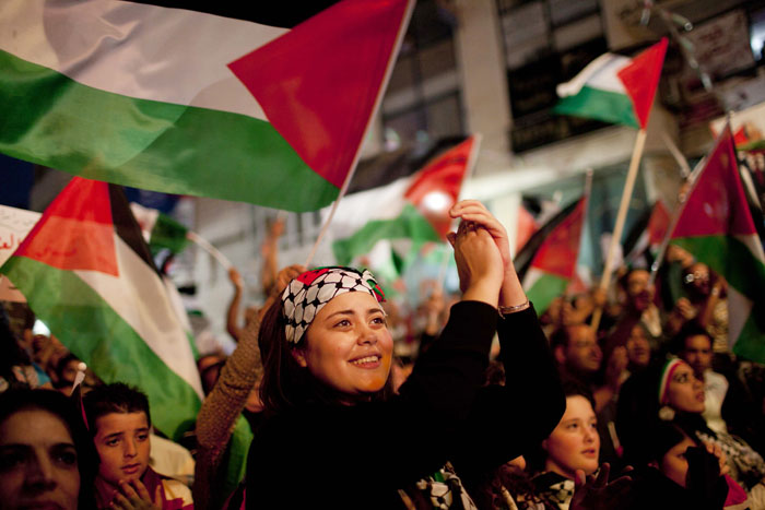 Palestinians in the West Bank city of Ramallah, cheer moments before their president, Mahmoud Abbas, addressed the General Assembly of the United Nations today.