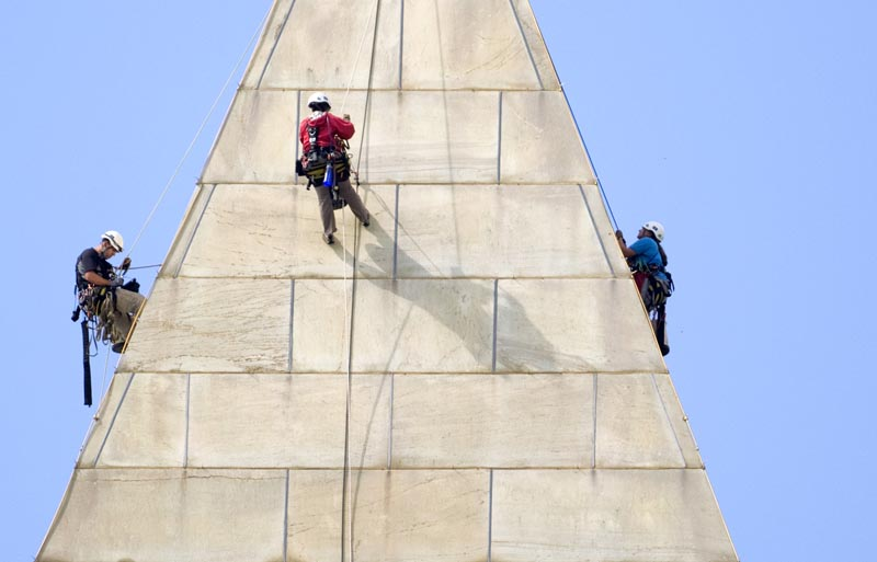 A team of engineers – from left, Dan Gach, Emma Cardini and Katie Francis – inspect the exterior of the Washington Monument for damage caused by last month's earthquake.