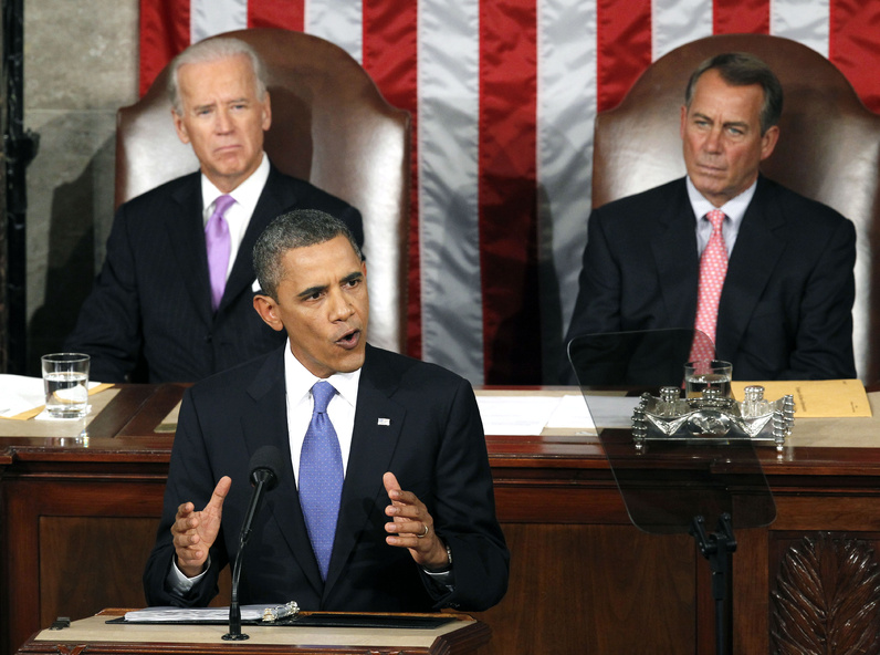 President Barack Obama speaks to a joint session of Congress Thursday. Watching are Vice President Joe Biden and House Speaker John Boehner.