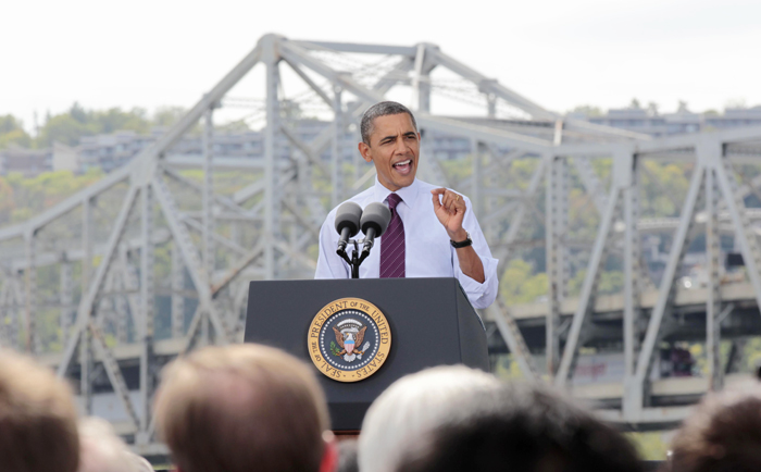 President Barack Obama promotes his American Jobs Act Now legislation today in Cincinnati with the aging Brent Spence Bridge as a backdrop.