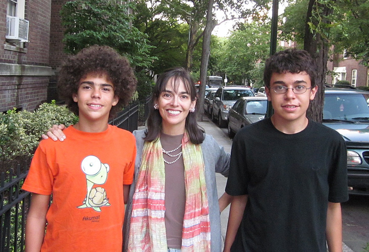 This photo provided by the family shows Lenore Skenazy, center, with her sons Izzy, 13, left, and Morry, 15, outside their apartment building in Queens. Skenazy wrote a book called