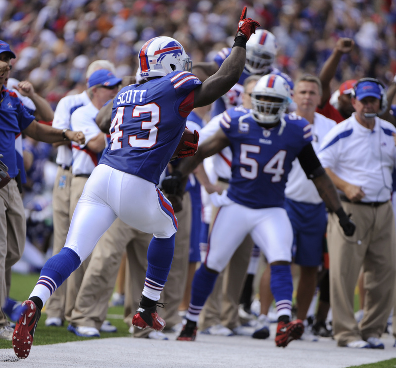Bryan Scott, 43, of the Bills cbrates his interception against the Patriotsin today's game at Orchard Park, N.Y. The Bills rallied for a 34-31 win. NFLACTION11